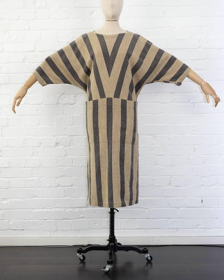 issey Miyake Plantation, circa 1980's khaki striped woven cotton dress with boat neck and two deep front pockets.  Japan: Medium  50% linen 50%cotton   Shoulder to Shoulder 42cm Waist 108cm, Length 112cm