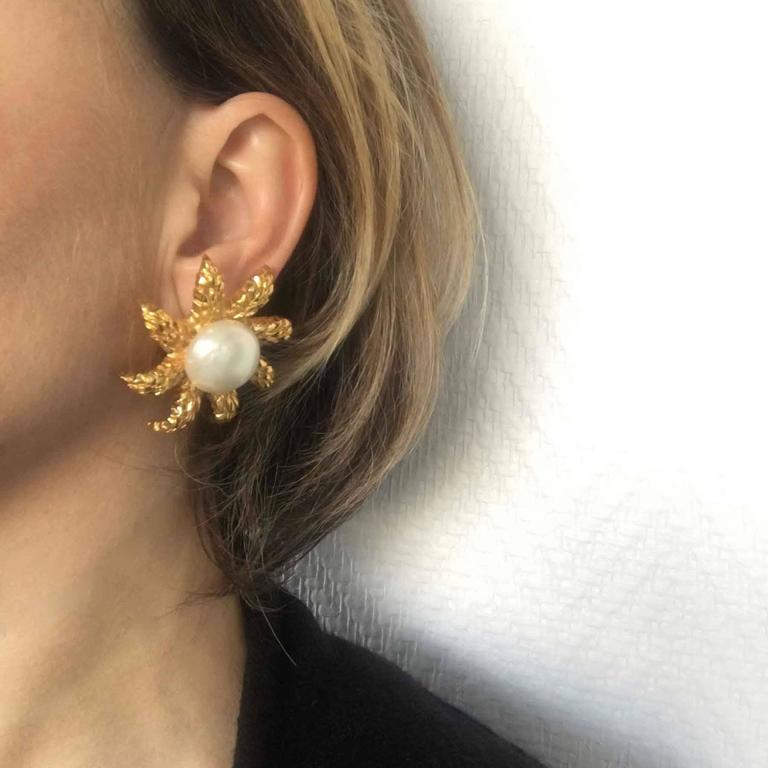 Stunning Chanel clip-on earrings wheat ears crown in gilt metal with a beautiful glass pearl in the center. CHANEL engraved on the back of each earclip.  In good condition. A clip was soldered to the back of the buckle (visible in the