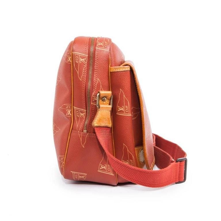 Collector! Louis Vuitton Limited Edition America's Cup 1587 bag in coated canvas and cowhide leather.  It has a large inner zippered pocket and a second outer flap pocket with a zipped inner pocket. Adjustable coral color strap.  Smooth natural