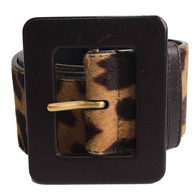 YSL Yves Saint Laurent Rive Gauche belt in foal leopard. Metal rectangular buckle covered with brown leather (little stain barely visible). A small trace on the leather inside (see photo).  Size:  - at the first hole: 79,5 cm - in the middle: 85