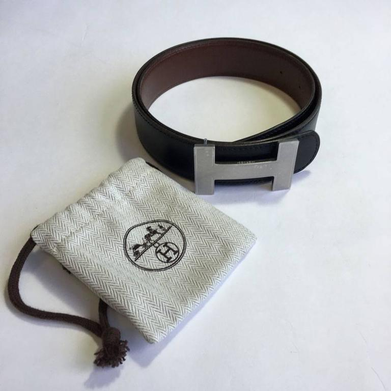 Superb HERMES belt H, palladium hardware, in reversible black and brown leather.   Size 72FR approximately, will correspond to a Size 10 US.  There is a protective film on the H loop .  Dimensions:  length of the belt : at the first hole: 69,5 cm -