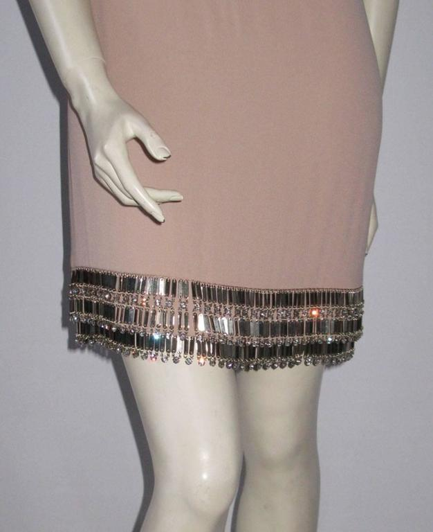 Stunning! AZZARO short dress in pink color. Straight cut, straight collar, sleeveless. Large square neckline at the back.  The bottom of the dress is decorated with an embroidery of crystals and pendants.  Invisible zipper on the right side and a