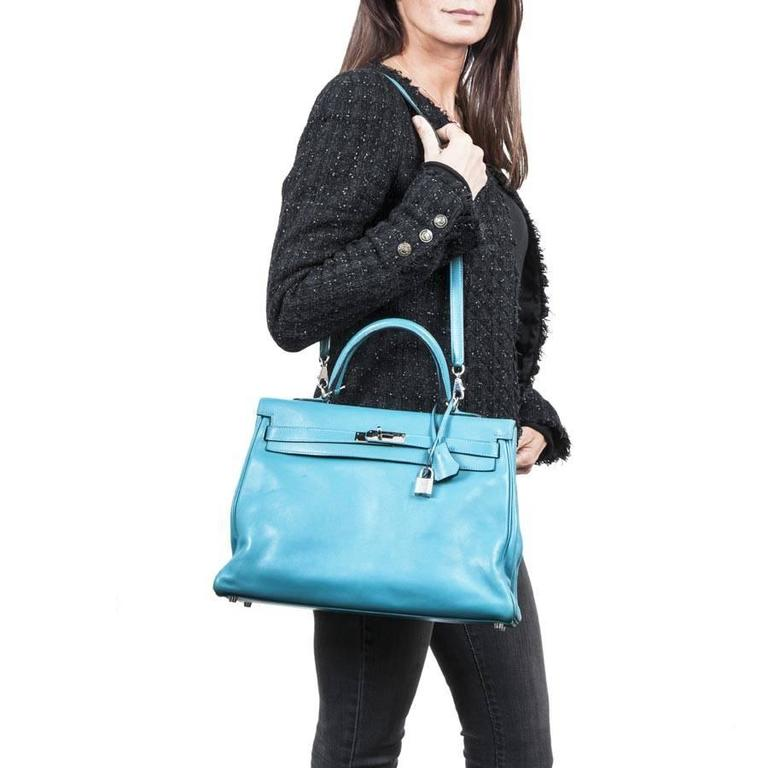 HERMES Kelly II 35 bag in izmir blue swift calfskin leather with shoulder strap, padlock, keys, zipper and bell.  Leather interior with two slits and a zipper pocket. Traces of wear on corners and under the bag. Letter R in a square Year 2014.  Worn