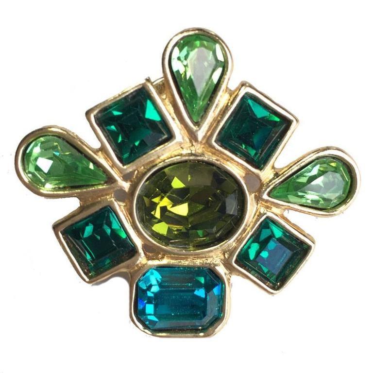 345b7402fe5 YVES SAINT LAURENT brooch pins in gilded metal and green stones For Sale