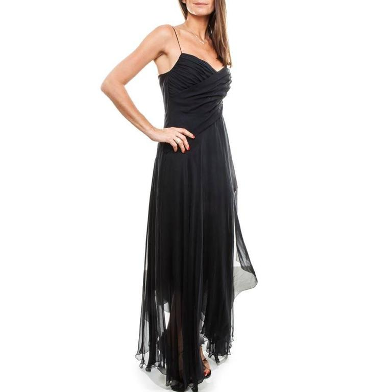 Chanel Long and Flowing Dark Blue Silk Evening Dress. Fluid cut, with zipper on the left side of the dress: 40 cm long. Crossed ruffles on the chest and on the lower part asymmetrically.  The lining on the chest is in night blue moiré satin which is