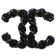 CHANEL Brooch in Ruthenium Metal Braids and Black Pearls