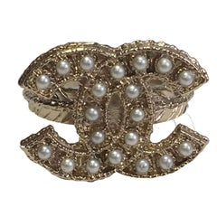 CHANEL 'CC' Ring Size 50FR in Gilt Metal set with Pearls