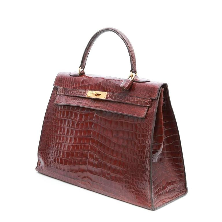 6ee82a37d2 Hermes 'Kelly' 35 handbag in brown semi matt crocodile porosus with padlock.  No