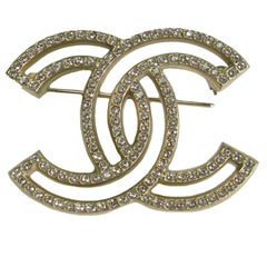 CHANEL Brooch Double C set with Rhinestones in Gilded Metal