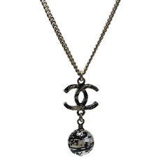 CHANEL Pendant Necklace in Gilded Metal and Pearl with Graffiti Effect
