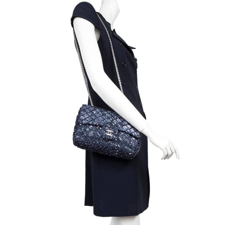 Limited series. Chanel timeless bag with sequins blue night. New condition. The flap is lined with black leather and the inside is lined with black satin.  There is a zipped pocket.  The hardware is made of palladium-ruthenium metal.  Ideal for a
