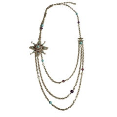 CHANEL Necklace in Gilded Metal, Pearls and Purple and Blue Molten Glass