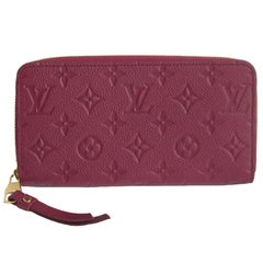 LOUIS VUITTON organizer in Monogram Embossed Grape Color Leather