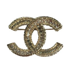 CHANEL CC Brooch in Gilded Metal set with Rhinestones