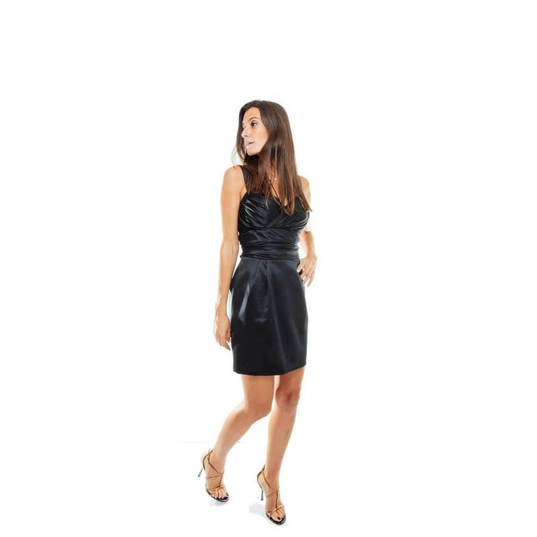 Dolce & Gabbana Cocktail dress in black silk. Strapless cut with integrated frame and straps, zipped at the back.  Dimensions flat:  low width: 48 cm