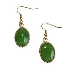 MARGUERITE DE VALOIS Stud Earrings in Light Green Molten Glass