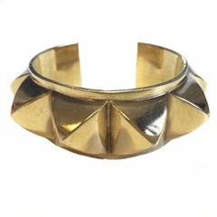 HERMES Rigid Cuff Bracelet 'Collier de Chien' in Gilded Metal