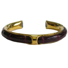 Vintage HERMES Bracelet in Gold Plated Metal and red H Crocodile Leather