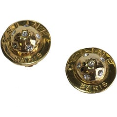 Vintage CELINE Half Sphere Clip-on earrings in Gilded Metal and Rhinestones