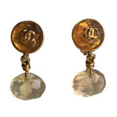 CHANEL Clip-on Earrings in Gilded Metal and Amber Resin