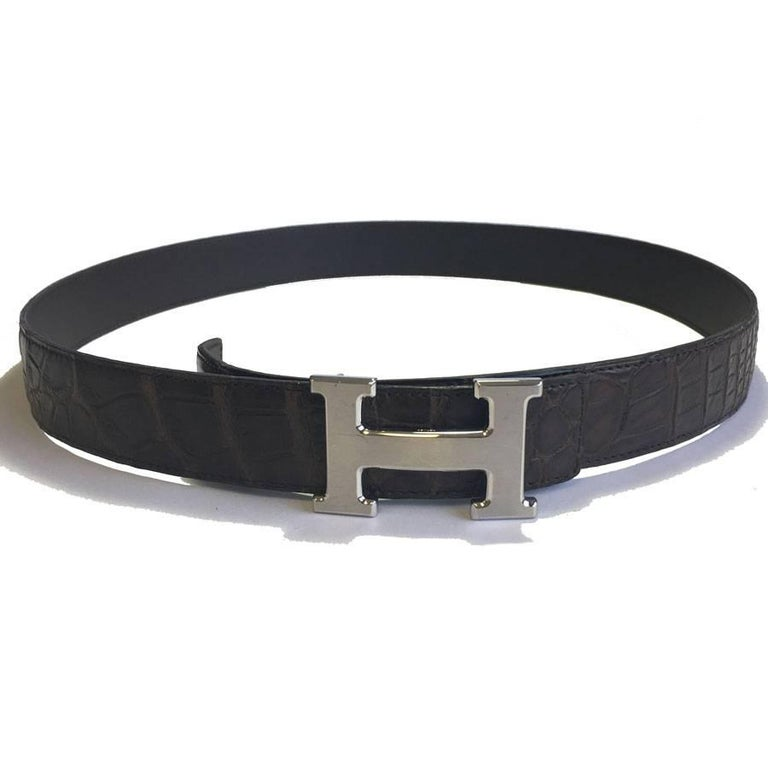 Hermes men's belt in brown porosus crocodile, H buckle in brushed palladium silver.  Belt with three holes, possibility to add.  Dimensions: from the loop to the central hole: 92.5 cm - width: 3.2 cm.  H: 6x3.7 cm  Delivered in a Valois Vintage