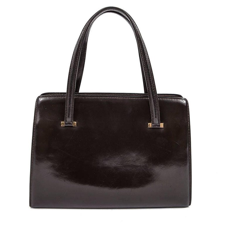 Hermès vintage 'Pullman' bag in brown box leather. Gilded metal hardware.  Inside there are 3 storage spaces, very convenient.   will be delivered in a dustbag