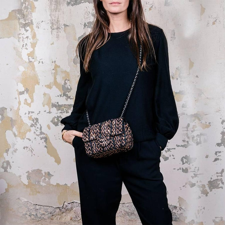 Chanel mini evening flap bag, in black leather embroidered with black and aged gold sequins.  It comes from 2016 pre fall runway. No hologram, no authenticity card. New condition.  Worn on the shoulder or crossover with a shoulder strap of 120