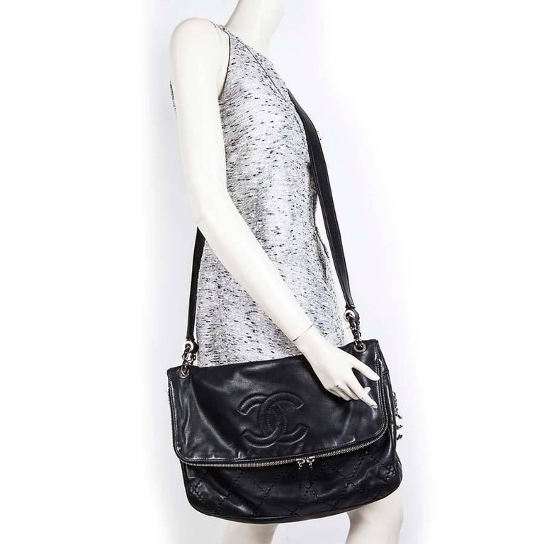 22cde3c8b81564 Chanel black quilted soft leather messenger flap bag, for women or men.  Very wide