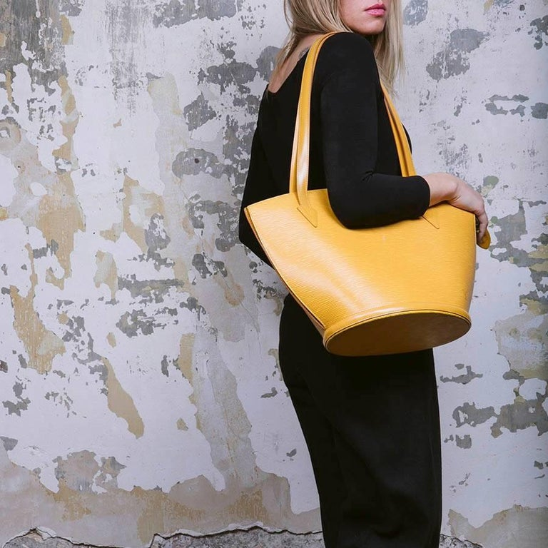 aa64e9bec6a6 Louis Vuitton Saint Jacques bag in yellow epi leather. Gilded metal  hardware. Zip closure