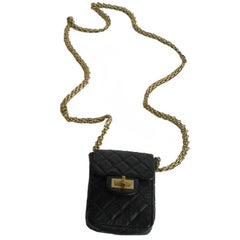 Chanel Clutch in Aged Black Quilted Leather with 2.55 Gold Plated Metal Clasp