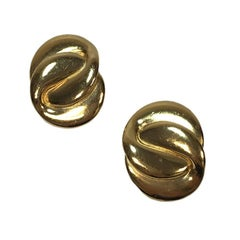 YVES SAINT LAURENT Vintage Clip-on earrings in Gilt Metal
