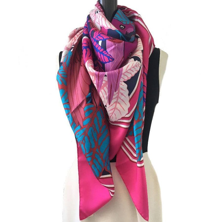 Large Hermès 'Les Perroquets' scarf in bright pink, navy and blue silk. New condition.  Made in France. drawn by: Joachim Metz  Dimensions: 140x140 cm  Will be delivered in its Hermes box