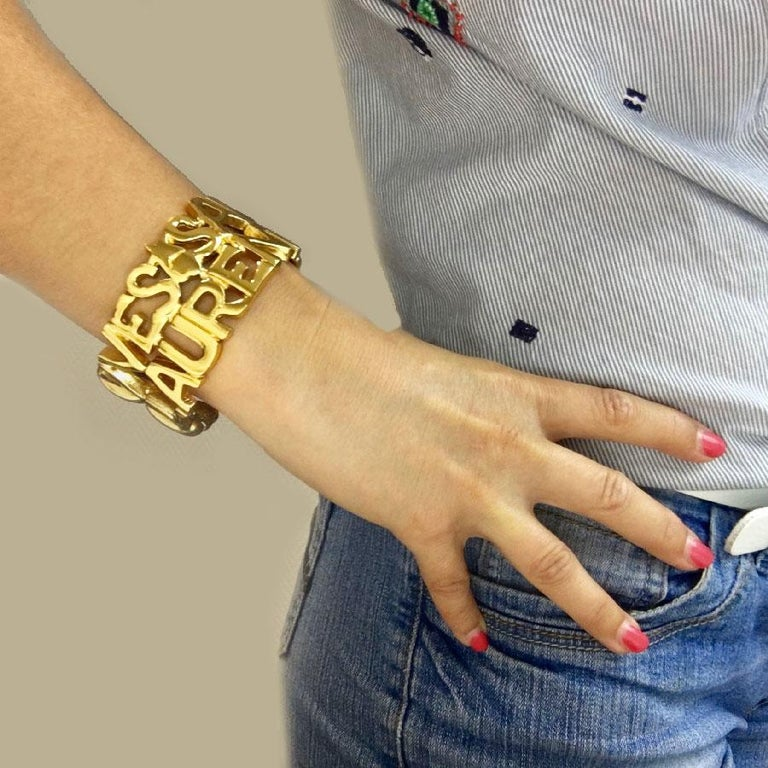 bf185ee86e2 YSL Yves Saint Laurent vintage cuff bracelet in gilt metal. Collector  piece. Made in