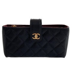 CHANEL Small Quilted Pouch in Black Caviar Leather