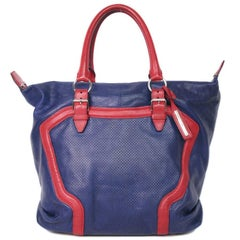 a9d45ba8b Alexander McQueen Bag in Red and Blue Electric Perforated and Grained  Leather