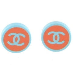 CHANEL Round Clip-on Earrings in Blue and Coral Resin