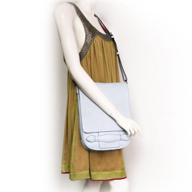 Very pretty Sonia Rykiel satchel in tinted blue sky grained calfskin leather.  Simple and functional, the bag is compartmentalized in three parts. Its cotton interior is composed of three interior pockets including one zipped and the other two