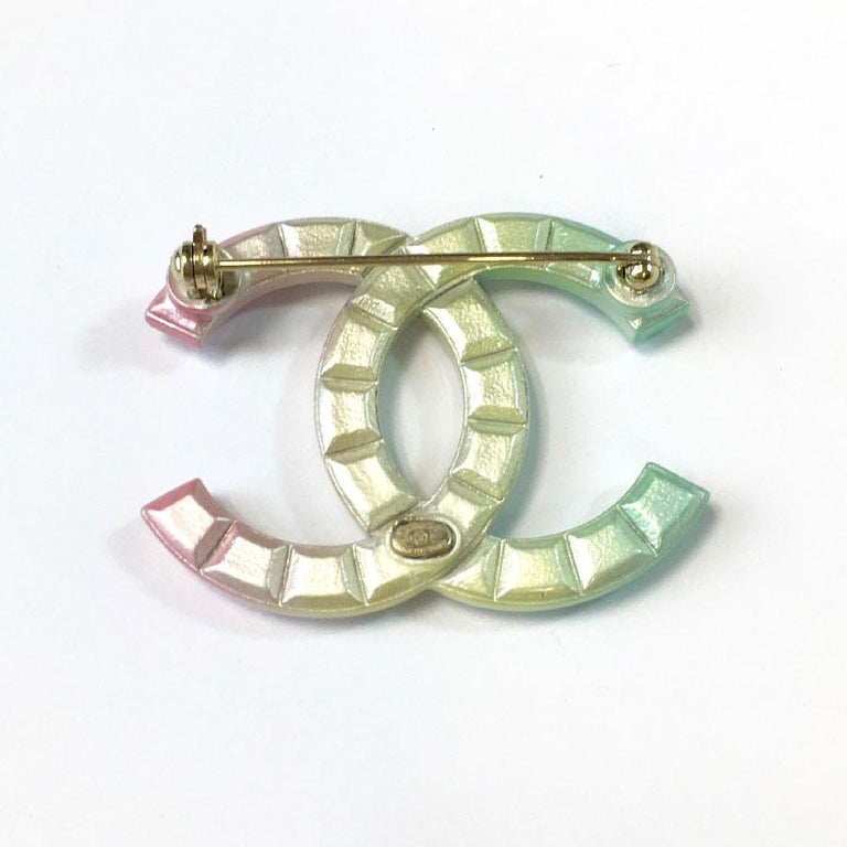Chanel CC brooch, diamond tips shape, in tricolor metal.  Immaculate condition. Made in France, spring-summer 2013 collection  Dimensions: 4,5x3,2 cm  Will be delivered in a black box (no Chanel), Chanel ribbon and Camellia Chanel in white fabrics