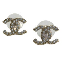 CHANEL CC Stud Earrings  in Gilt Metal set with Pearl Beads.