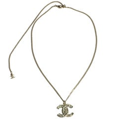 CHANEL CC Pendant Necklace in Gilt Metal and Brilliants