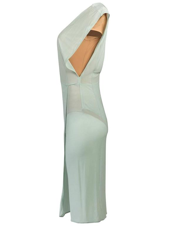 Maison Martin Margiela sheer sea foam dress featuring a deep v-neck and back, cap sleeves, and a layered front hem with a slit. Has a nude unitard underlay with a deep v-neck and shoulder pads. 2009 Runway Collection