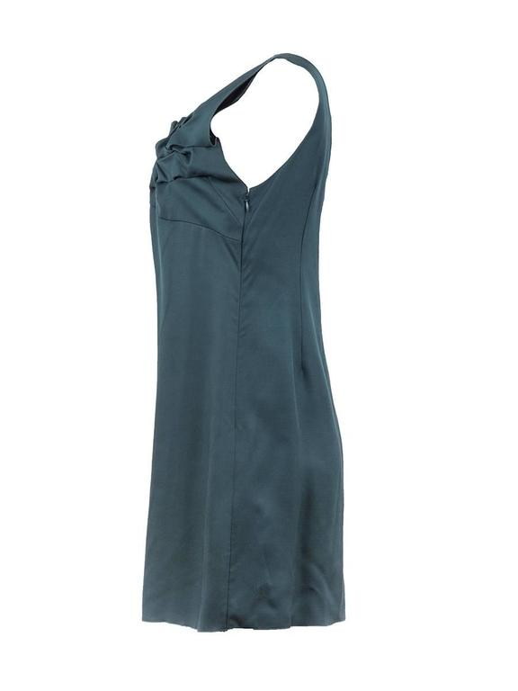 2007 Undercover emerald green mini sleeveless dress with a v-neck and mesh detailing in back. New with Tag.