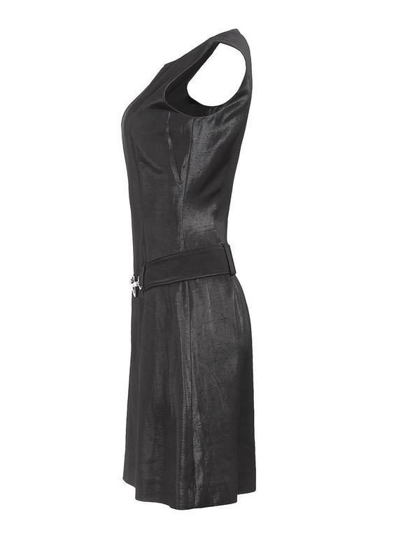 1980's Black silk sleeveless fitted mini dress with an attached metal horse bit buckled belt from PACO RABANNE and an invisible back zipper. New with tags.