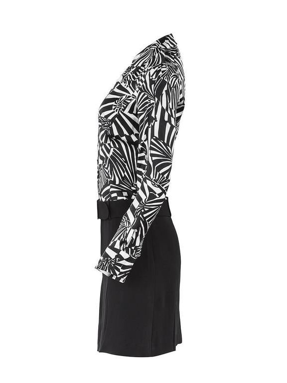 1980's Paco Rabanne black and white silk psychedelic print long sleeve shirt dress with a wool crepe skirt and an attached wide belt. New with Tags.