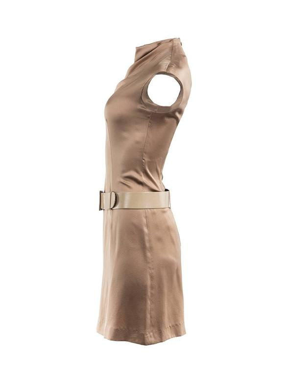 Gold silk sleeveless mini dress with a mock neck and hidden back zipper featuring an attached tonal wide belt from PACO RABANNE 1980's collection. New with Tag.