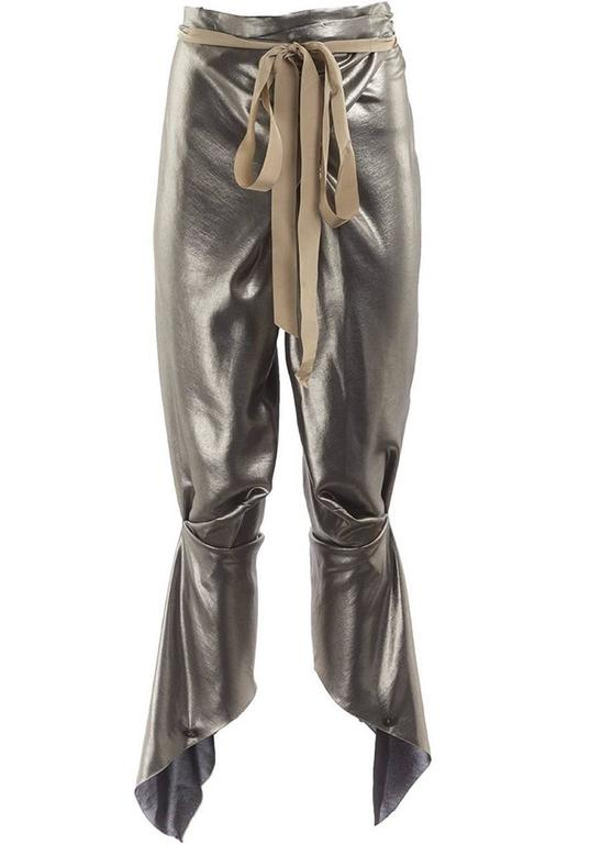 2010 Thimister Couture draped metallic silver lamé wrap harem pants with a raw silk self-tying waist sash, adjustable button closures at the ankles and pleating at knees. New with Tag.
