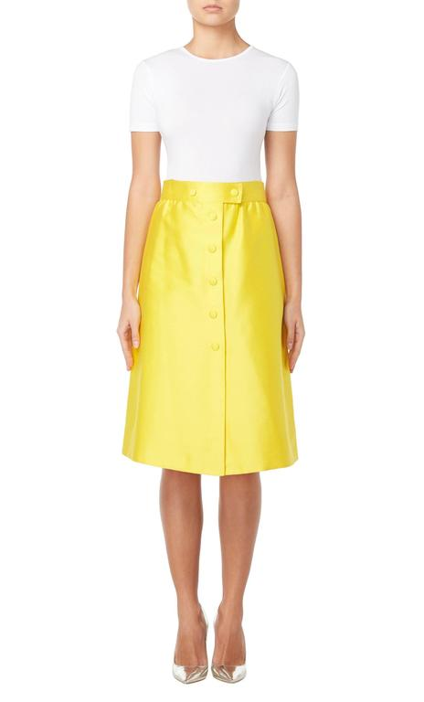 Inject a pop of colour into a modern wardrobe with this vibrant Courrèges skirt. Fastening to the front with yellow press studs, the skirt has a pronounced A-line silhouette with a waistband drawing the eye to the small of the waist. Team with a