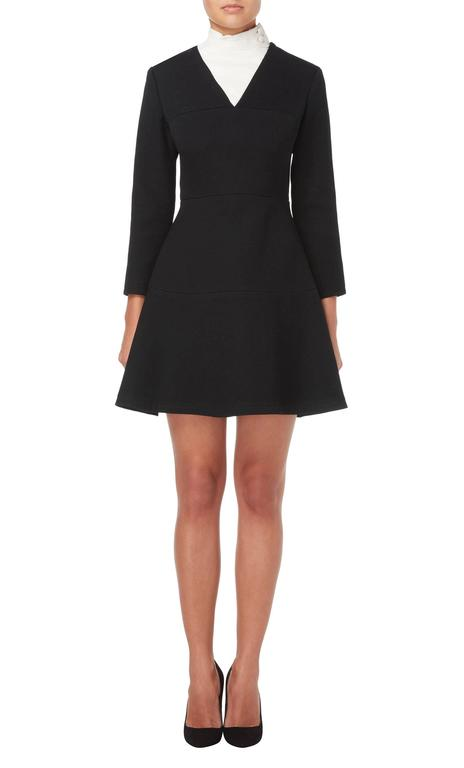 A fantastic example of the futuristic aesthetic pioneered by Cardin in the 1960s, this mini dress is still incredibly modern. Constructed in black wool, the mini dress has a deep v-neckline with an integral white leather bib that fastens on the neck