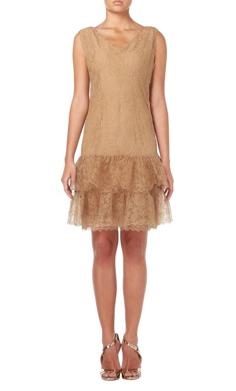 A stunning piece of haute couture, this Balenciaga cocktail dress is constructed in caramel lace and lined in silk. The perfect choice for parties and cocktail events, the sleeveless dress features a flattering v-neckline and drop waist silhouette.
