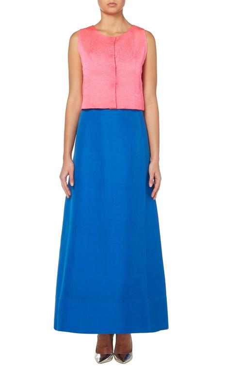 This colourful ensemble by Balenciaga for his early Eisa label is amazingly versatile. With a sleeveless top in shocking pink cloqu̩ silk and a bright blue silk gazaar maxi skirt, the piece also has the original pair of matching shoes. Wear